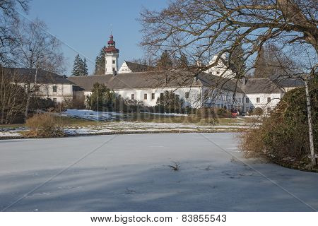 Castle Velke Losiny With A Frozen Pond In The Park