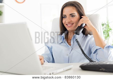 Business Woman Phoning In Office