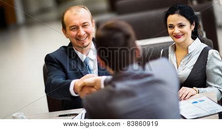 people shaking hands finishing up a meeting