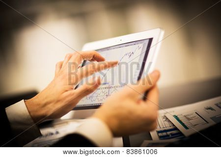 Businessman with finger touching screen