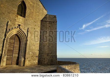 Sunset On Church Facing The Sea