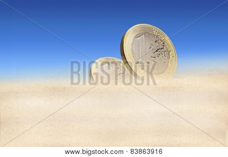 Two euro coins in a desert
