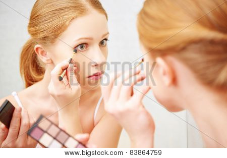 Young Beautiful Woman Apply Makeup Eyeshadow Front Of  Mirror