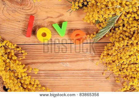 Yellow Mimosa On Wooden Boards
