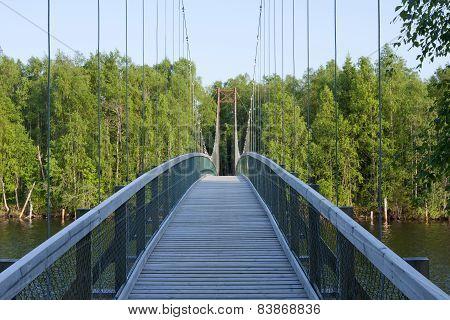 Suspension, wooden bridge over a river.