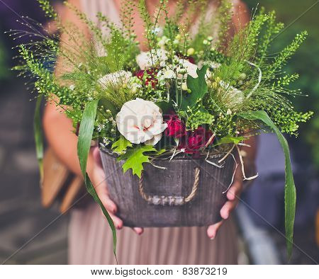 Close-up Of Woman Hands Keeping Flowers Basket