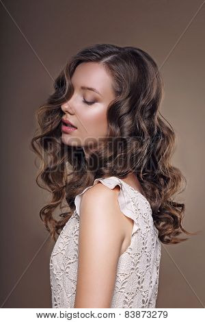 Studio Portrait Of Young Dreamy Brunette With Closed Eyes