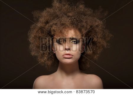 Individuality. Woman With Shaggy Waved Hair