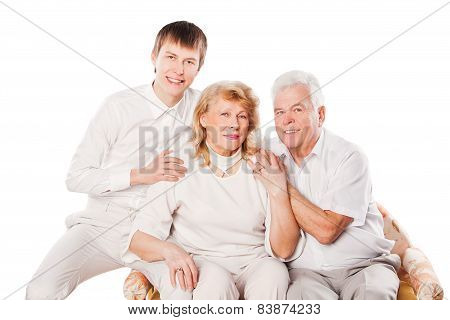 Portrait of happy senior couple and son on white background