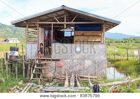 Nacpan, Philippines - January 17, 2015 : Children In A Traditional Home In The Small Village Of Nacp