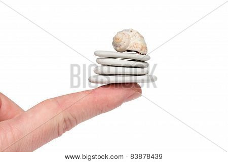 White Stones Balanced On A Finger