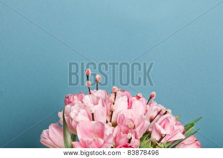 Close-up View Of Bouquet Of Pink Fresh Tulips With Pussy-willow Blue Backround