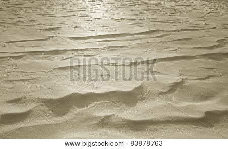 Sand Drifts Against Light Absorption During Sunset