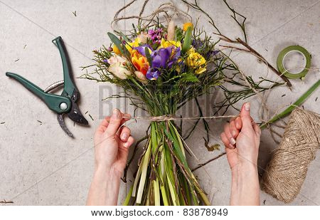 Hands Of Florist Making Bouquet Spring Flowers