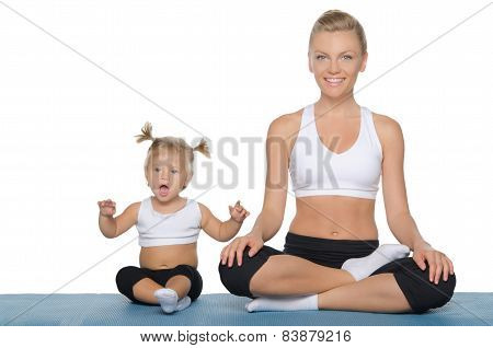 Happy Mom And Daughter Engage In Fitness On Mat
