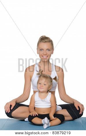 Smiling Mom And Daughter Doing Yoga On Mat