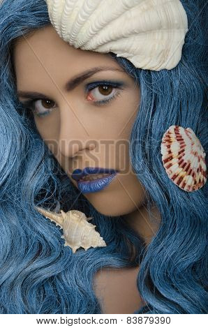 Young Woman With Blue Hair And Seashells