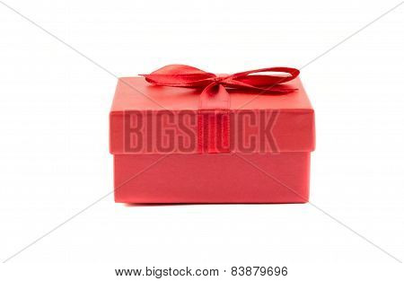 Red Box With A Ribbon On A White Background