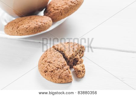 oatmeal cookie with coffee wooden white background