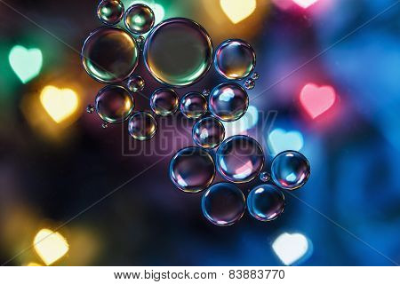 Oil Floating On Background With  Heart Backlight
