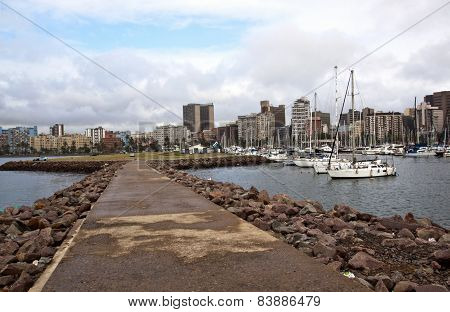 Pedestrian Pier In Durban Harbour With Yachts And Buildings In Background