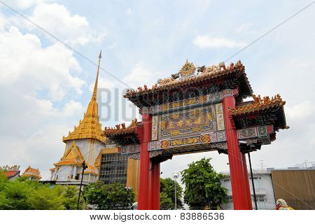Chinatown gate with Wat Traimit temple, Bangkok, Thailand