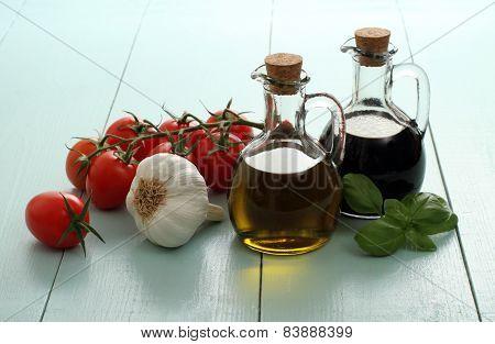 Olive Oil And Vinegar In Vintage Bottles On Wooden Table