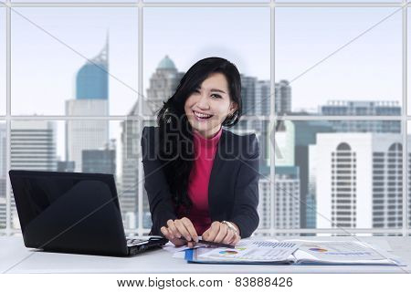 Attractive Female Worker Working In Office