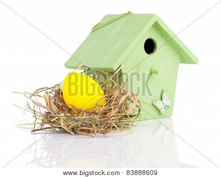 Easter Eggs With Birdhouse, On A White Background