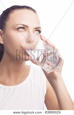 Young Caucasian Lady Drinking Water From Glass. Standing Isolated Over White Background