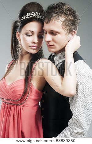 Portrait Of Young Caucasian Couple In Love Posing In Studio