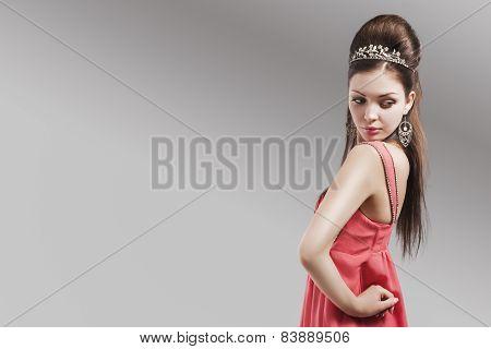 Sensual Caucasian Female In Evening Pink Dress Wearing Tiara