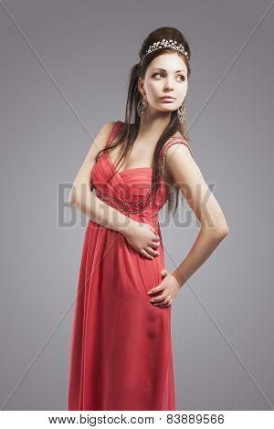 Portrait Of Sensual Relaxing Caucasian Woman In Oink Evening Dress. Woman Wearing Silver Queen Crown