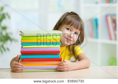 Smart kid girl preschooler with books