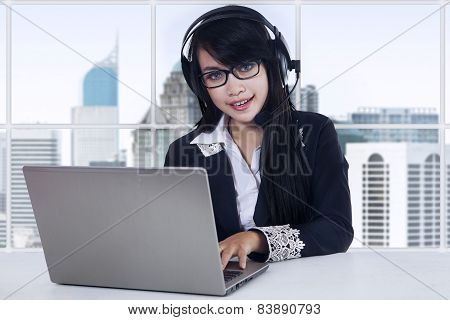 Female Operator At Workplace In The Office
