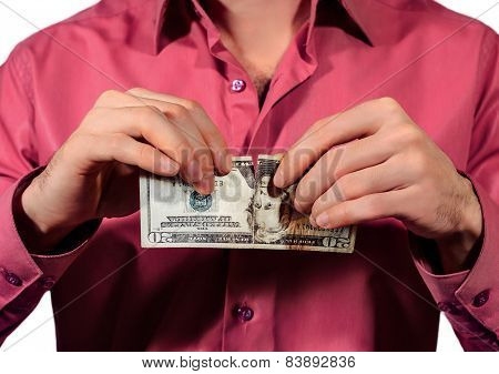 Man Tearing 20 Us Dollars Banknotes Isolated On A White