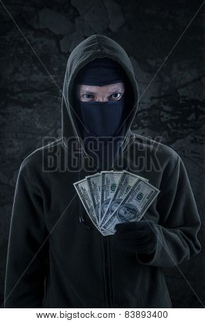 Robber Holds Money Stolen