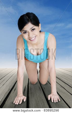 Woman Workout On The Wooden Floor