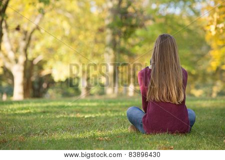 Rear View Of Sitting Girl