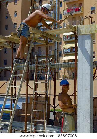 Construction site: workers concrete slab structure