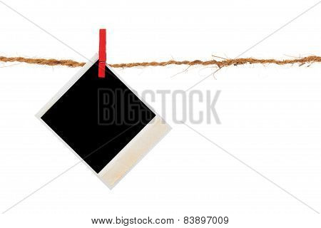 Blank Photo Hanging On A Clothesline Over White Background