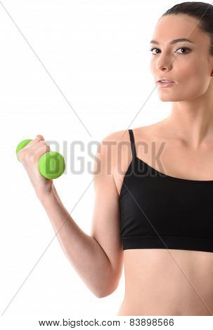 Portrait of fitness woman working out with dumbbell