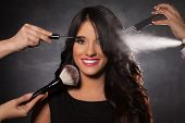 picture of hairspray  - Beautiful young happy fashion model at full beauty treatment applying professional makeup and hairdressing - JPG