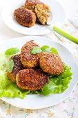stock photo of patty-cake  - Fish cakes fried in bran crumbs on plate - JPG