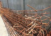 stock photo of reinforcing  - Steel rods used to reinforce concrete in construction site - JPG