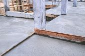 stock photo of concrete pouring  - floor wet mixed concrete at construction site - JPG