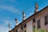 stock photo of vicenza  - Some statues used as ornament on the rooftop of an historical palace in the center town of Vicenza - JPG