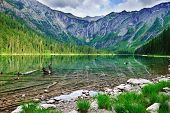 stock photo of avalanche  - Avalanche lake with reflection in Glacier National Park - JPG
