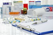 picture of paracetamol  - Lot of medicine pills and doctor note - JPG