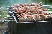 pic of frizzle  - Preparation of meat slices in sauce on fire - JPG